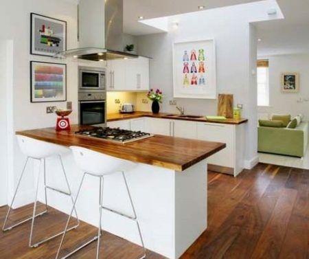 cozinha com ilha de apartamento
